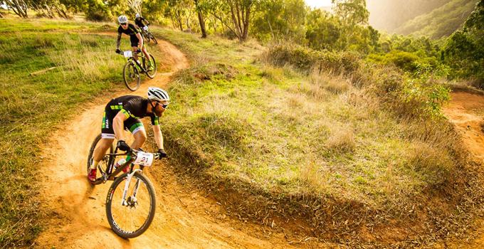 Image of Nick mountain biking through a dirt trail