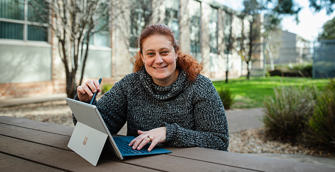 Student at university with laptop